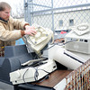 Jonathan Wedge, attendant at the Joplin Recycling Center, sorts through old electronic items on Wednesday at the facility.<br /> Globe | Laurie Sisk