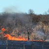 Globe/Roger Nomer<br /> A grass fire spread over a 5-7 mile area north of Galena on Sunday afternoon.