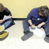 Darrell Wigent, 30, left and Annis Barnes, 24 find a quiet area to fill out employment applications on Tuesday during Job Fair 2014 at the Holiday Inn Convention Center. Hundreds of job seekers met with more than 50 employers during the event.<br /> Globe   Laurie Sisk