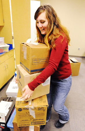 Joplin school bus driver Tammy Thompson helps bring in boxes of school items to the new Soaring Heights Elementary School Thursday afternoon, Jan. 2, 2014, in Duquesne. Soaring Heights combines the students from Duquesne and Duenweg elementary schools.<br /> Globe   T. Rob Brown