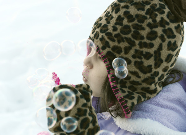 Globe/Roger Nomer<br /> Unity Pritchard, 4, blows bubbles in an attempt to see if they will freeze on Monday afternoon.