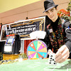 Chase Kraft, of Kraft Insurance, deals a hand of blackjack during the Joplin Area Chamber of Commerce Business Expo on Wednesday afternoon at the Holiday Inn Convention Center.<br /> Globe | Laurie Sisk