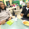 Dalvin Taylor, right, Missouri Southern State University junior, Grenada, Miss.,  reacts after his friend, Xavier Graham, MSSU junior, Biloxi, Miss. informs him he has a bingo. The two were competing Friday with other MSSU students for gift cards to local restaurants during a Campus Activities Board event to celebrate the Chinese New Year in Billingsley Student Center.<br /> Globe | Laurie Sisk