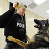 Joplin Police Department K-9 handler Jeremy Bland plays ball with Pax, a 2-year-old German shepherd Monday afternoon, Jan. 6, 2014, at the department's main offices in downtown Joplin.<br /> Globe | T. Rob Brown