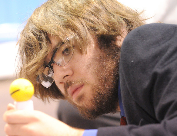 Chris Kennell, 16, of Belton, tries to construct a tower to hold a golf ball during the problem solving competition on Friday at the Technology Students Association regional conference at Missouri Southern State University.<br /> Globe | Laurie Sisk