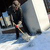 Globe/Roger Nomer<br /> Cory Spencer, Joplin, shovels snow on a sidewalk along Fourth Street on Monday morning.