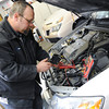 Globe/Roger Nomer<br /> Rick Harlen checks the charge on a battery at Ivey's Service Center on Friday morning.
