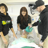 "From the left: Missouri Southern paramedic students Jayden Butts, Megan Jeans and Josh Nichols intubate a ""Sim Man""  at MSSU's Simulation Center for Interdisciplinary Clinical Education on Wednesday afternoon.<br /> Globe 