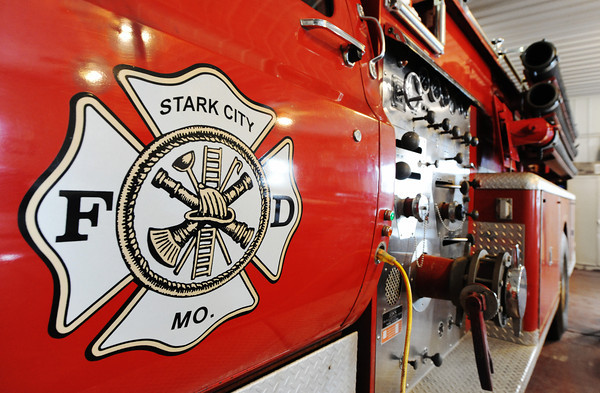 One of the Stark City Fire Department vehicles rests in the department's building Thursday afternoon, Jan. 9, 2014, ready for a call. Stark City and Fairview fire departments are hoping to combine their departments and levy a tax to help them get new equipment and operating funds.<br /> Globe | T. Rob Brown