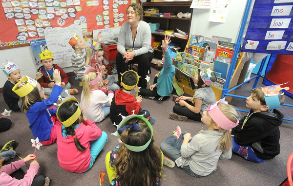 Students answer questions during Kansas Trivia in Jennie Butterfield's first grade class at Baxter Spring's Lincoln Elementary on Wednesday. Students were celebrating both Kansas' birthday and the 100th day of school.<br /> Globe | Laurie Sisk