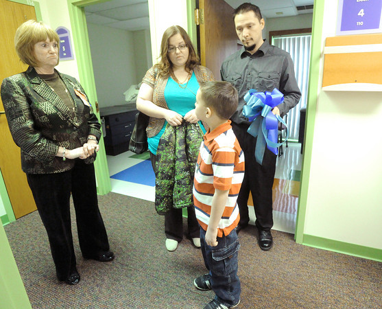 Teresa Malaun, director of clinics for Children's Mercy South, Overland Park, chats with 7-year-old Braidon Lantz at the new Children's Kansas City clinic at Freeman west.  Also pictured are Braidon's parents, Becky and Brandon Lantz.<br /> Globe | Laurie Sisk