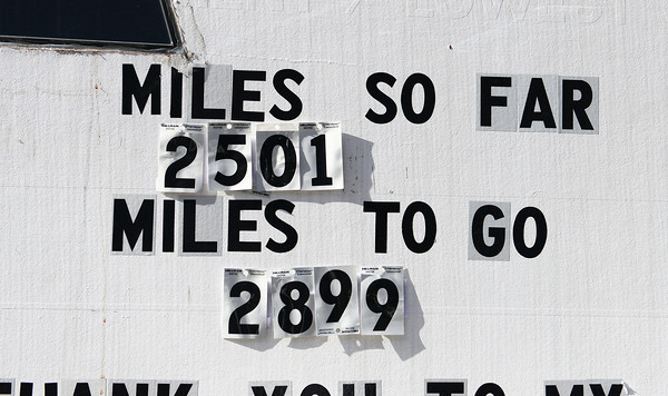 Globe/Roger Nomer<br /> A sign on Rob Jones' trailer keeps track of his miles traveled during his cross-country bike ride.