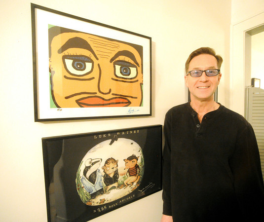 Mark Woodin stands beside an original Ringo Starr work of art (top) in his Joplin home.<br /> Globe | Laurie Sisk