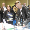Ciera Karr, 52, center, of Duenweg and Charky Maggard, right, of Springfield inquire about employment opportunities at Total Document Solutions on Tuesday during Job Fair 2014 at the Holiday Inn Convention Center. Hundreds of job seekers met with more than 50 employers during the event.<br /> Globe   Laurie Sisk