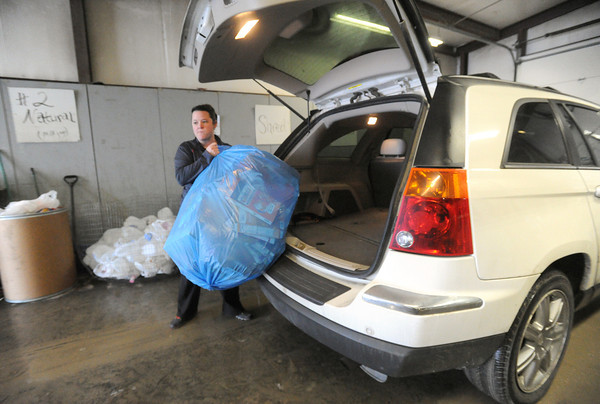 Pittsburg resident Rena Johnston unloads recyclables on Thursday at the SEK Recycling Center.<br /> Globe | Laurie Sisk