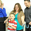 Freeman President and Chief Executive officer Paula Baker, left, reacts as 7-year-old Braidon Lantz cuts a ribbon in celebration of a new clinic and partnership with Children's Kansas City. Also pictured are Braidon's parents, Becky and Brandon Lantz.