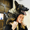 Joplin Police Department K-9 handler Jeremy Bland holds Pax, a 2-year-old German shepherd over his shoulder Monday afternoon, Jan. 6, 2014, at the department's main offices in downtown Joplin.<br /> Globe | T. Rob Brown