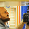 Tim Valentine, an electrician with Bill's Electric of Joplin, cuts a hole through wood for a light fixture at the new Soaring Heights Elementary School Thursday afternoon, Jan. 2, 2014, in Duquesne. Soaring Heights combines the students from Duquesne and Duenweg elementary schools.<br /> Globe | T. Rob Brown