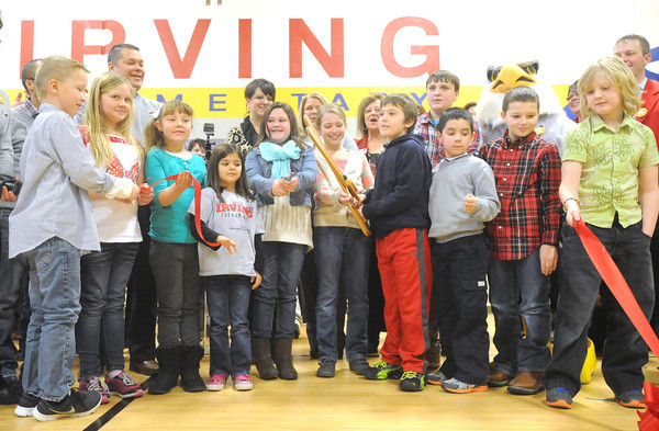 Irving elementary studnets do the honors during a ribbon cutting ceremony for the new Irving Elementary School on Friday morning. The $18.5 million facility replaces the former school, which was destroyed in the May, 2011 tornado.<br /> Globe | Laurie Sisk
