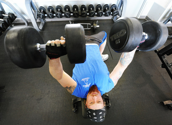Cody Haggard of Webb City lifts weights at the Joplin Family Y Monday afternoon, Jan. 6, 2014, at the downtown Joplin facility. Several Family Y patrons said it was a bit busier than usual for that time of the day/week, likely due to the colder outdoor temperatures.<br /> Globe | T. Rob Brown