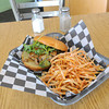 The Island Stylee is sushi grade tuna with a sriracha vinaigrette. The mixture is formed into a patty and served on a bun with arugula. Here, the entree is pictured with a side of carrot fries. <br /> Globe | Laurie Sisk