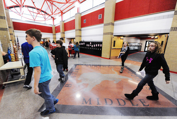 Baxter Springs (Kan.) Middle School students walk through the new school's main cooridor Wednesday afternoon, Jan. 8, 2014, between classes.<br /> Globe   T. Rob Brown