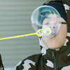 Globe/Roger Nomer<br /> Kaine Babbitt, 8, blows a bubble in an attempt to see if it will freeze on Monday afternoon.