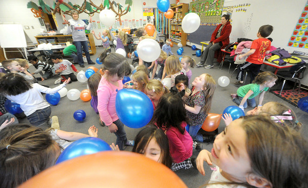Kiindergarten children in both Janet Williamson's and Nikki Williams' classes celebrate the first 100 days of school this academic year on Wednesday at Lincoln School in Baxter Springs. Pictured lower right is kindergartner Grace Murray.<br /> Globe | Laurie Sisk
