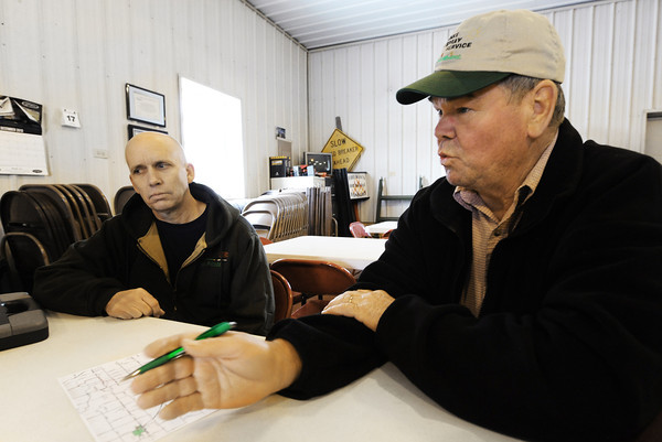 Stark City Fire Chief James Palmer (left) and committee chairman Delmar Hunke of rural Stark City talk about fire department needs Thursday afternoon, Jan. 9, 2014, at the Stark City Fire Department. The department hopes to combine with the Fairview Fire Department and get a tax levy to make necessary upgrades.<br /> Globe | T. Rob Brown