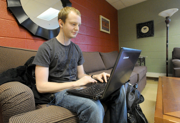 Missouri Southern junior Taylor Shanks, Joplin, studies on Tuesday afternoon at the Spiva Library. Shanks said affordable tuition on a local or national level is necessary to keep up in a global economy.<br /> Globe| Laurie Sisk
