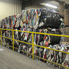 Tausha Ritz, manager of the SEK Recycling Center, looks over the numerous bales of clothing on Thursday at the center.<br /> Globe   Laurie Sisk