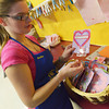 Globe/Roger Nomer<br /> Bella Stemm, senior, shows off some of the finished Valentine's Day cards produced by her class at Riverton High School.