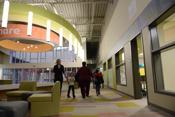 Globe/Roger Nomer<br /> Students make their way through the halls of the new Soaring Heights Elementary building on their first day in the new facility on Thursday.