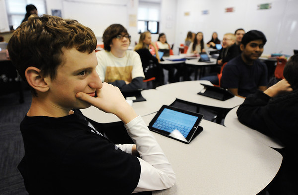 Baxter Springs (Kan.) Middle School eighth grader Max Sheffer (left) listens to his English language arts teacher Wednesday afternoon, Jan. 8, 2014, at the new middle school.<br /> Globe | T. Rob Brown