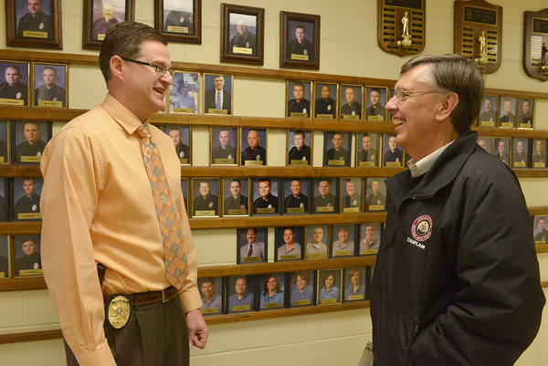 Globe/Roger Nomer<br /> Joplin Police Lt. Brian Lewis talks with Chaplain Tim Sumners at the Joplin Police Department on Friday morning.
