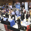 Droves of job seekers meet with potential employers during Job Fest 2014 on Tuesday at the Holiday Inn Convention Center. More than 50 area businesses participated in the event.<br /> Globe | Laurie Sisk