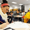 Baxter Springs (Kan.) Middle School eighth grader Kortney Sills (left) takes notes on the skeletal system during Stephanie Dewey's science class Wednesday afternoon, Jan. 8, 2014, at the new middle school.<br /> Globe | T. Rob Brown