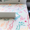 Globe/Roger Nomer<br /> Via Christi staff signed one of the final beams to be placed on the hospital's new surgery center.