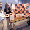 From the left: Carthage High School freshman Madison Burt, Sadie Freeman and Caitlin Tracy prepare to display their gold medal winning projects during the Family Career and Community Leaders of America Region 11 awards ceremony on Friday at Missouri Southern State University. with the honors, the trio will advance to the FCCLA state competition in late March in Columbia. Burt's project was a career investigation into sales management, while Freeman and Tracy teamed up to raise money for the local Ronald McDonald House by collecting pop tabs from cans. About 1,500 students from 20 schools participated in the event.<br /> Globe | Laurie Sisk