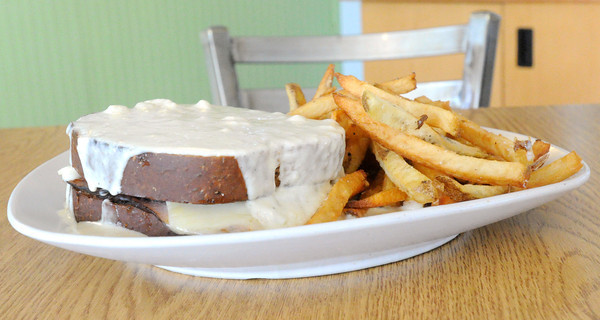The Croque Monsier features grilled ham and gruyere on wheatberry bread. The entree is topped with mornay sauce and served with a choice of traditional fries or carrot fries.<br /> Globe | Laurie Sisk
