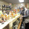 Sara Henry, manager of the SEK Recycling Center's New To You resale shop, arranges items on shelves on Thursday.<br /> Globe | Laurie Sisk