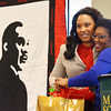 Globe/Roger Nomer<br /> Kelly Schoenbauer-Sales, left, receives a hug and gift basket from Faustina Abrahams, MSSU staff and diversity committee chairperson, following her speech on Monday at the Martin Luther King breakfast.