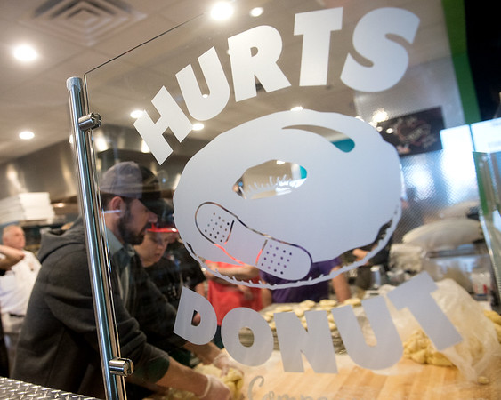 Globe/Roger Nomer<br /> Workers practice rolling dough on Monday at Hurts Donuts.