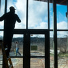 Globe/Roger Nomer<br /> Maurice Kratz, Kansas City, Mo., cleans windows as Dan Kelly, Joplin, sweeps on Monday at the Wildcat Glades Conservation and Audubon Center as part of the Martin Luther King Jr. Day of Service.