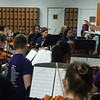 Globe/Roger Nomer<br /> Andrea Arzet leads the Neosho High School orchestra during practice on Thursday.