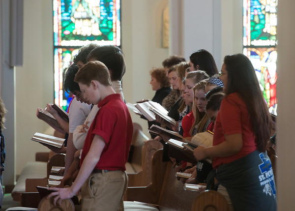 Globe/Roger Nomer<br /> Students from St. Peter's Middle School sing during Tuesday's mass in celebration of Catholic Schools Week at St. Mary's Catholic Church.
