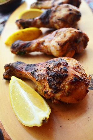 These chicken legs and tender and flavorful since they are marinated in yogurt, lemons and spices. You can cook them on the grill or oven.