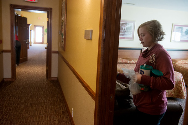 Globe/Roger Nomer<br /> Rachel Eckhardt, 12, cleans light switches on Monday at the Ronald McDonald House as part of the Martin Luther King Jr. Day of Service.