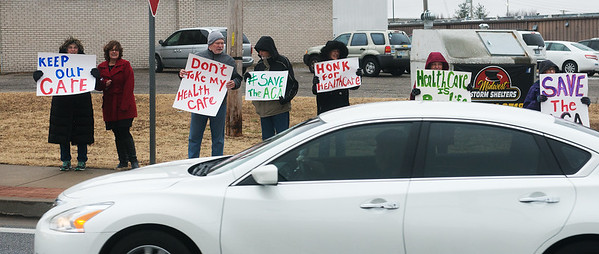 Globe/Roger Nomer<br /> Protesters holds signs in support of the Affordable Care Act on Tuesday at 32nd and Rangeline.
