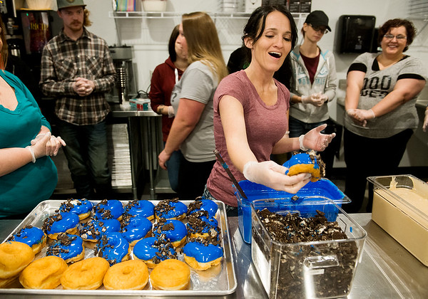 Globe/Roger Nomer<br /> Amy Thomas practices decorating a Cookie Monster donut on Monday at Hurts Donut.